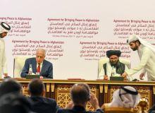 Acordul-de-pace-semnat-de-Zalmay-Khalilzad-trimisul-special-al-SUA-și-de-liderul-Taliban-Mullah-Abdul-Ghani-Baradar-Afganistan-Q-Magazine.jpeg